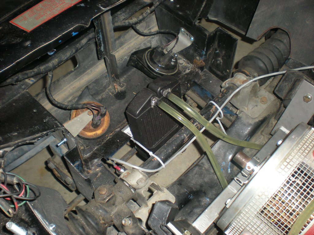 Radiator mounted under the front 8 cells